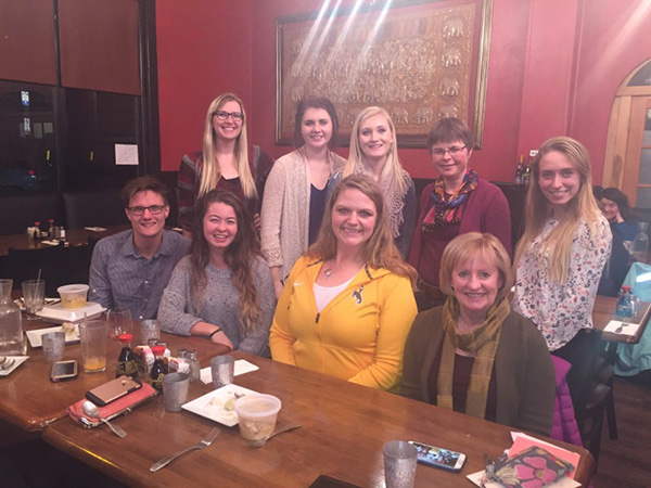 students with teacher in a restaurant